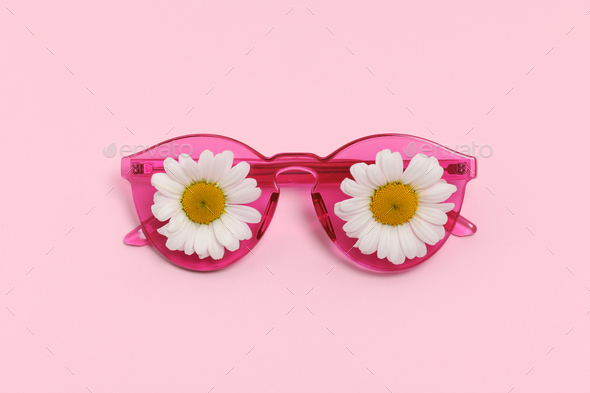 pink sunglasses with daisies - Stock Photo - Images