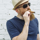 Bearded man smoking a cigar - PhotoDune Item for Sale