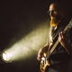 Bearded man playing bass guitar with spotlight - PhotoDune Item for Sale