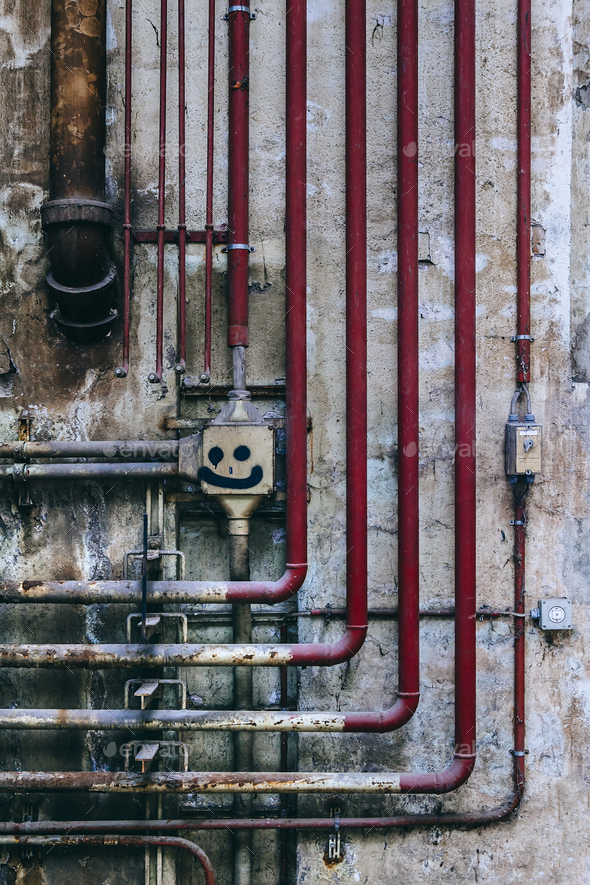 Old industrial wall of pipes and obsolete parts - Stock Photo - Images