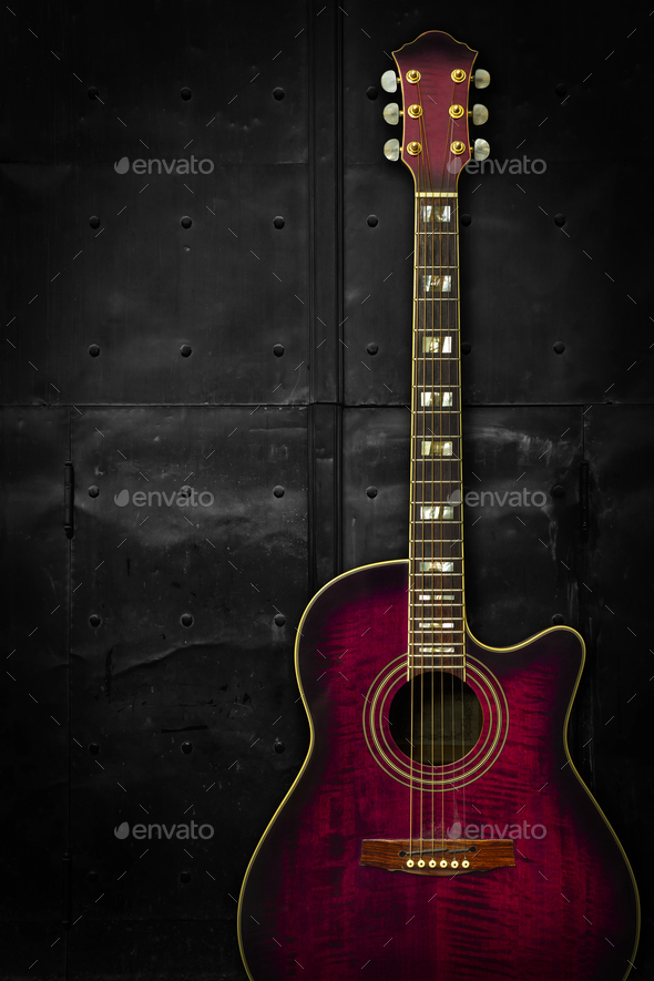Purple acoustic guitar over dark background - Stock Photo - Images