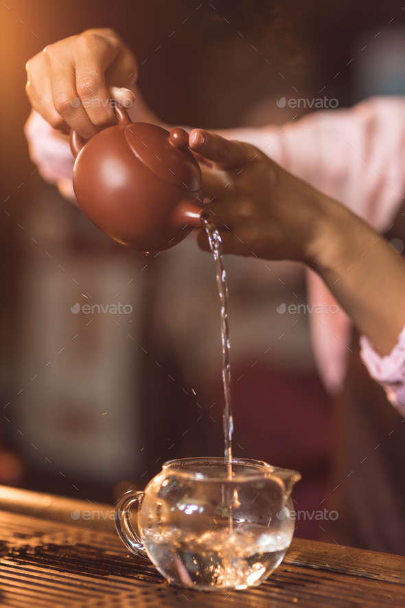 The tea master pours tea - Stock Photo - Images