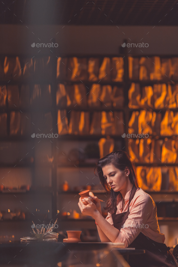 Young girl in workshop - Stock Photo - Images