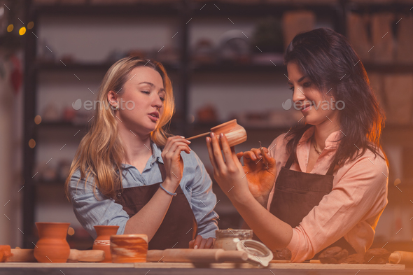 Young women in a pottery studio - Stock Photo - Images