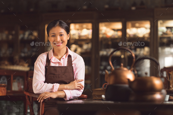 Smiling girl in a tea room - Stock Photo - Images