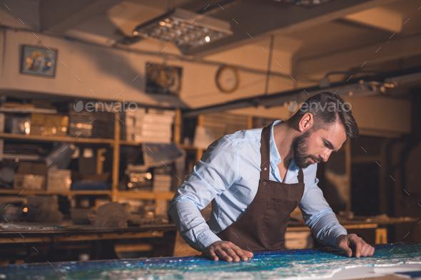 Mature master at artwork - Stock Photo - Images