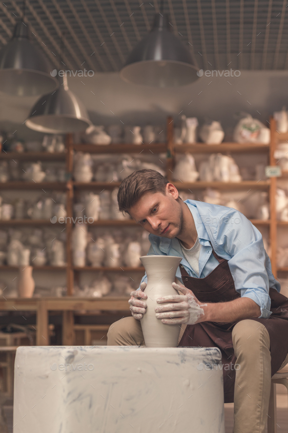 Young master working on a potter's wheel - Stock Photo - Images