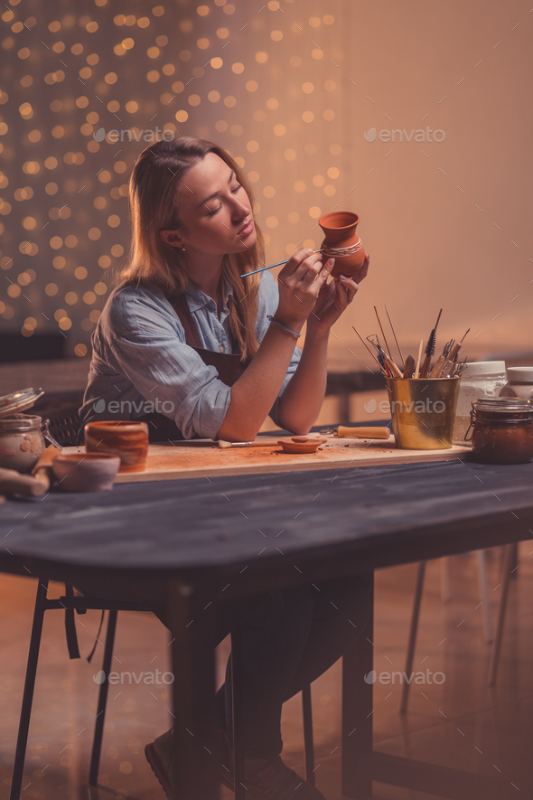 Young woman in a pottery studio - Stock Photo - Images
