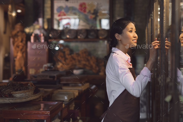 Young girl in a tea shop - Stock Photo - Images