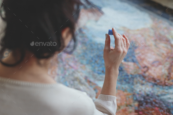 Young girl with a mosaic - Stock Photo - Images