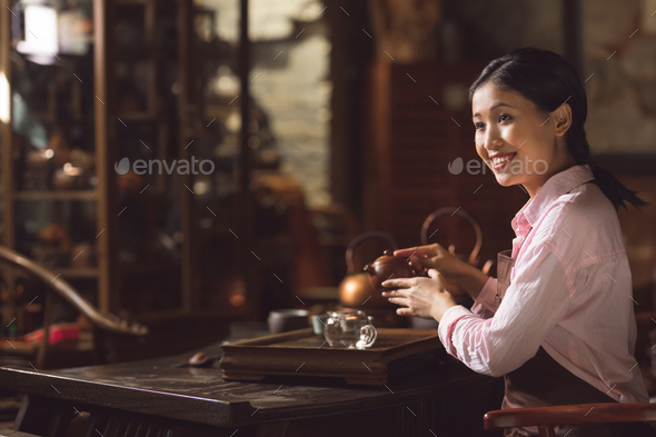 Young asian girl at tea ceremony - Stock Photo - Images