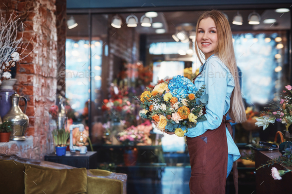 Smiling young woman in the store - Stock Photo - Images