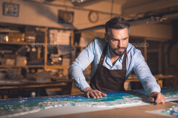 Mature man in an apron - Stock Photo - Images