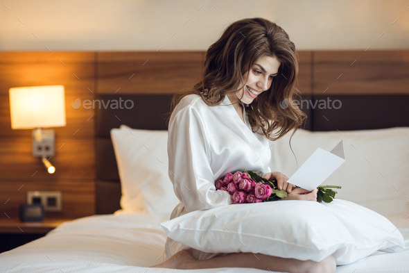 Smiling beautiful girl with flower - Stock Photo - Images