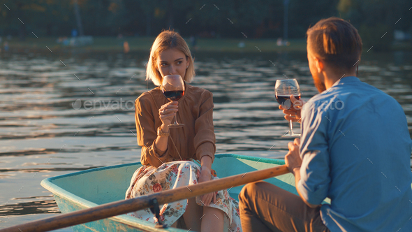 Attractive couple with glasses of wine - Stock Photo - Images