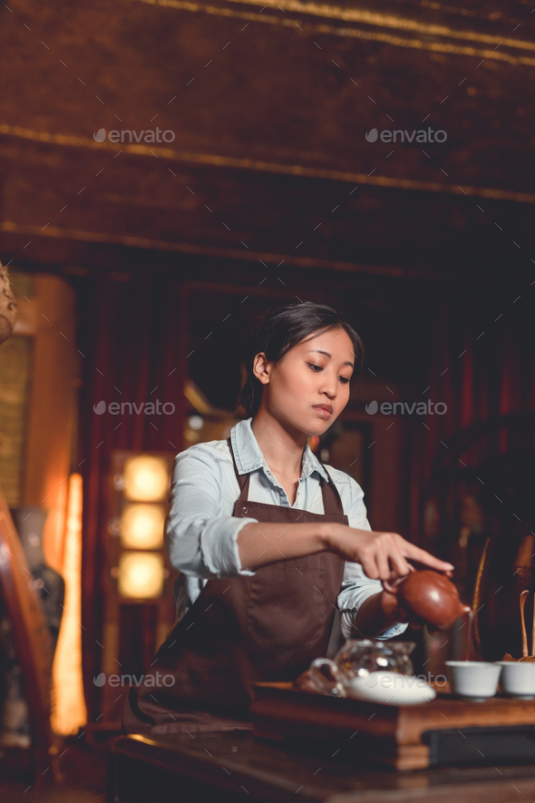 Tea master in a tea room - Stock Photo - Images