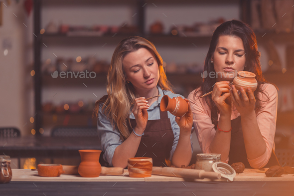 Attractive girls in a pottery studio - Stock Photo - Images