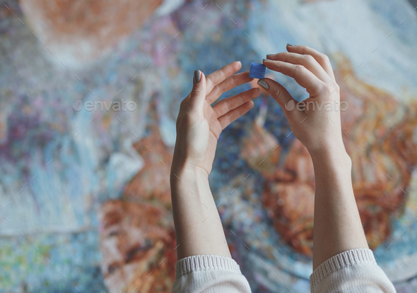 Women's hands with a mosaic - Stock Photo - Images