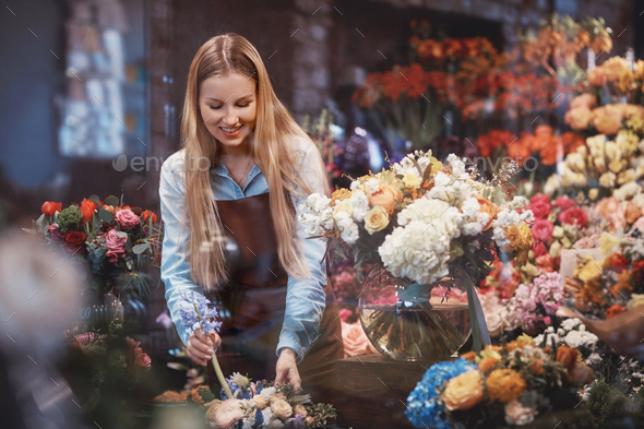 Young florist in the store - Stock Photo - Images