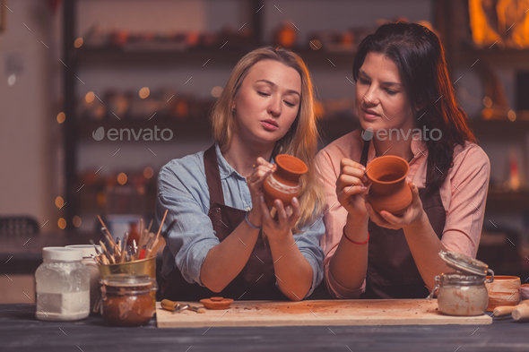 Young girls in a pottery studio - Stock Photo - Images