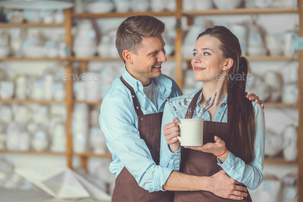 Young couple with a ceramic vase in pottery - Stock Photo - Images