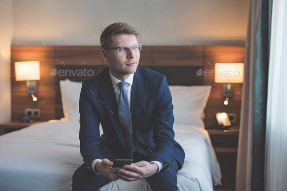 Young businessman in bedroom - Stock Photo - Images