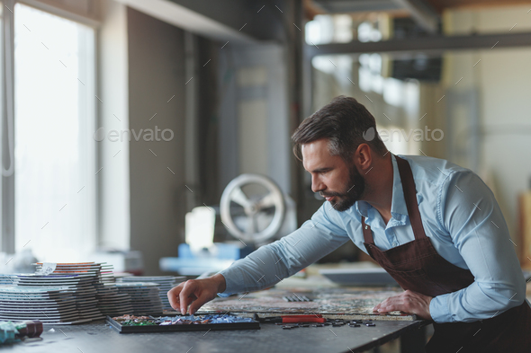 Young man at work in studio - Stock Photo - Images