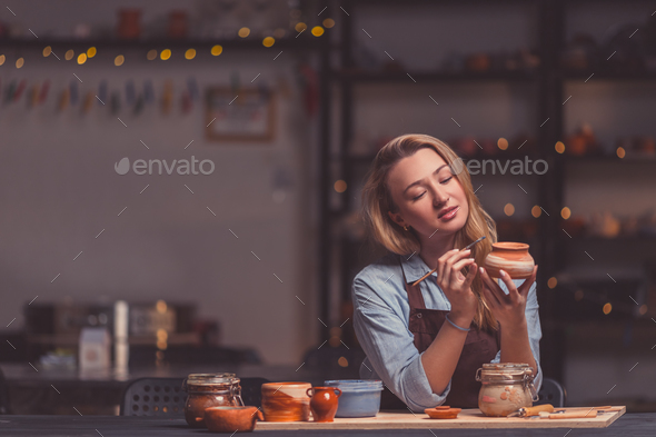 Attractive girl in a pottery studio - Stock Photo - Images