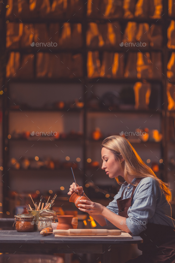 Attractive woman in workshop - Stock Photo - Images
