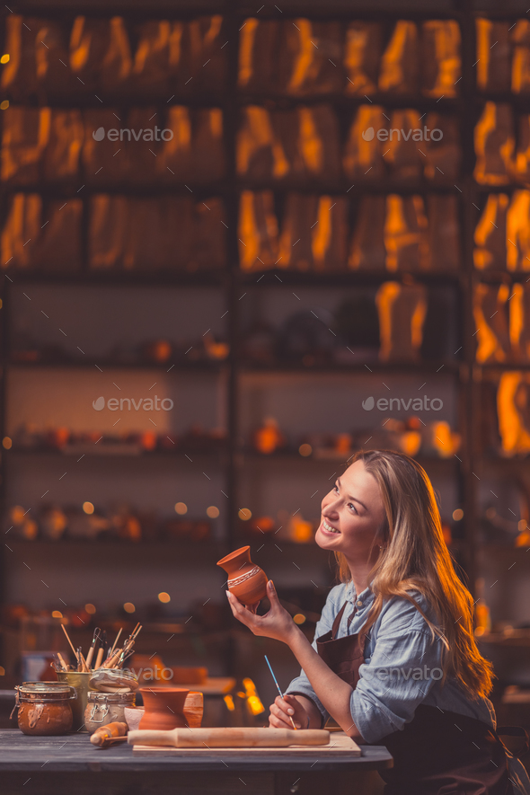 Smiling young girl in workshop - Stock Photo - Images