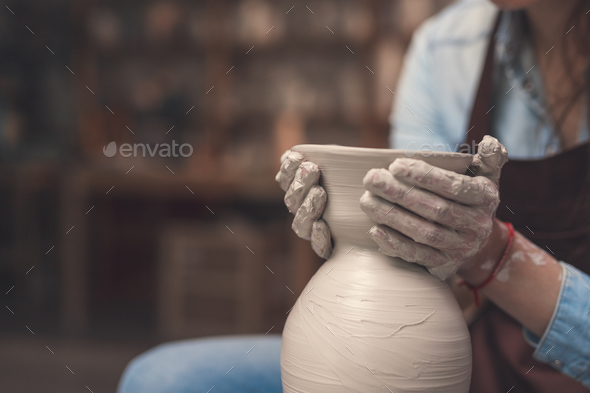 Smiling girl working in pottery - Stock Photo - Images