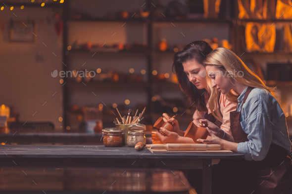 Attractive girls in workshop - Stock Photo - Images