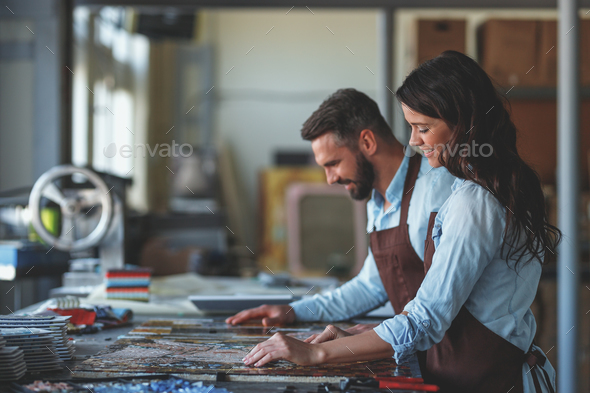 Smiling people with a mosaic in studio - Stock Photo - Images