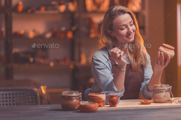 Smiling woman in studio - Stock Photo - Images