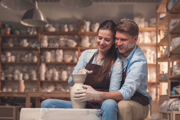 Young couple on a date in pottery - Stock Photo - Images