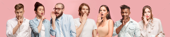 The young men and women whispering a secret behind hands over pink background - Stock Photo - Images