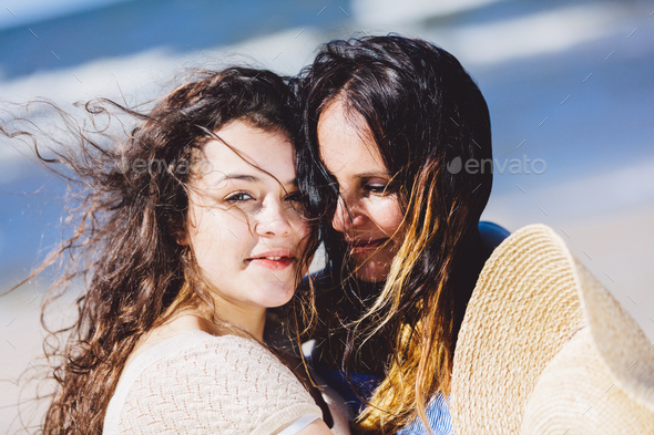 Two women, mother and daughter, hugging each other - Stock Photo - Images