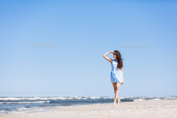 A young girl looking steadily at the sea. - Stock Photo - Images