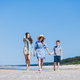 Mother and her two children walking on the beach - PhotoDune Item for Sale