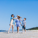 Mother with children walking by the sea - PhotoDune Item for Sale