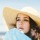 A portrait of a young girl in a straw hat. - PhotoDune Item for Sale