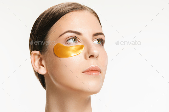 Beauty portrait of an attractive girl with a gold patch under the eye. - Stock Photo - Images