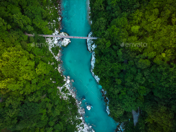 Wooden bridge over Soca river in Slovenia, top down drone image - Stock Photo - Images