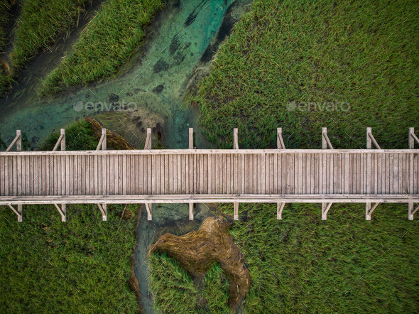 Top down aerial view over wooden footbridge in Zelenci,Slovenia - Stock Photo - Images