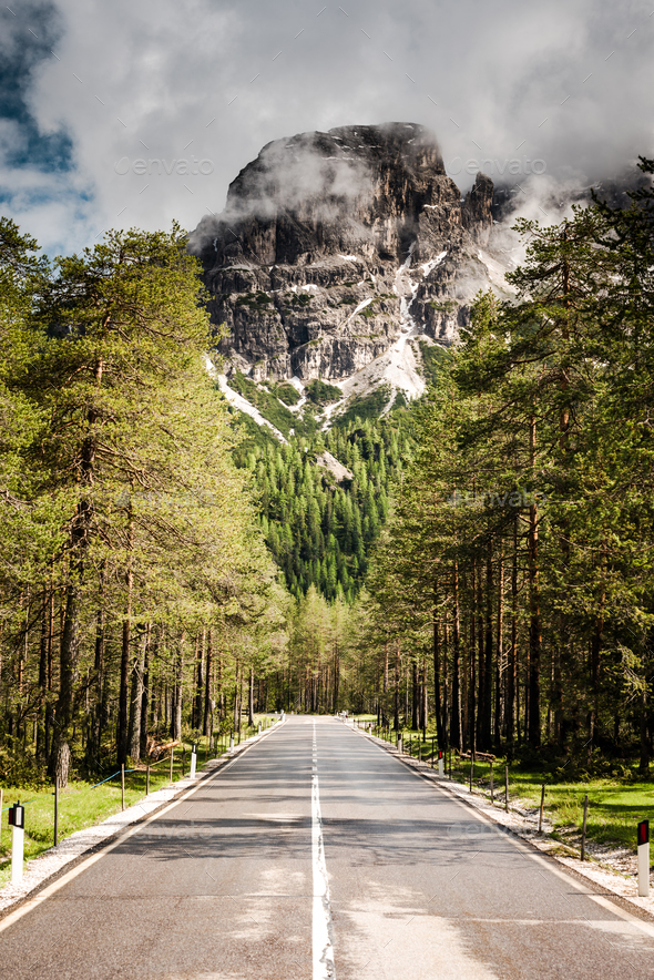 Road leading into mountain, road trip conept - Stock Photo - Images