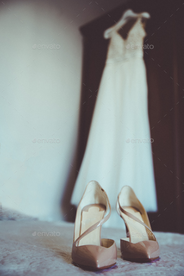 Wedding dress and wedding shoes on the bed. - Stock Photo - Images