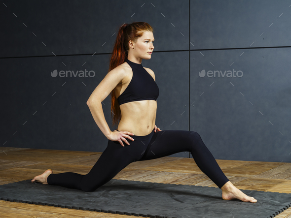 Beautiful redhead stretching her legs - Stock Photo - Images