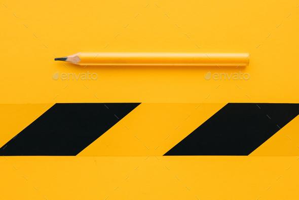 Classic yellow carpenter handyman pencil on same color backgroun - Stock Photo - Images