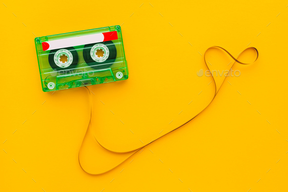 Top view of audio cassette with tangled tape - Stock Photo - Images