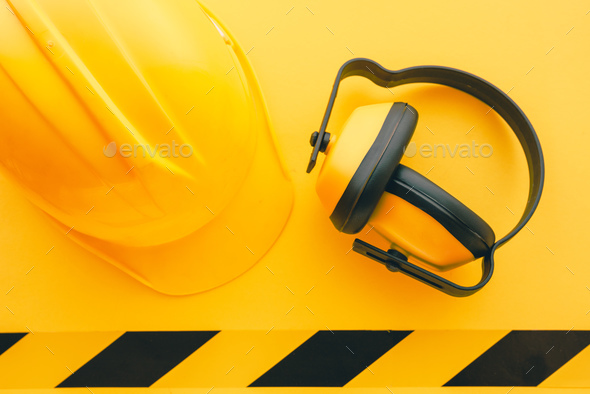 Protective construction helmet and earmuffs - Stock Photo - Images